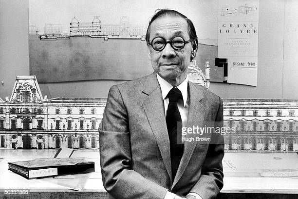 Architect IM Pei in his office standing in front of drawing of The Louvre Museum