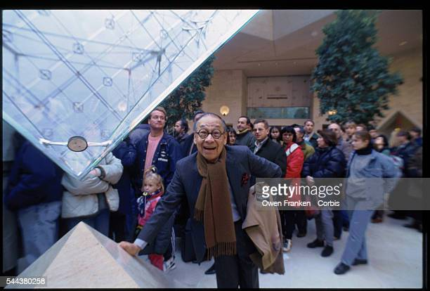 Architect IM Pei stands beside the tip of the Louvre's inverted pyramid in the Galleries of the Carrousel He designed the glass and metal pyramids to...