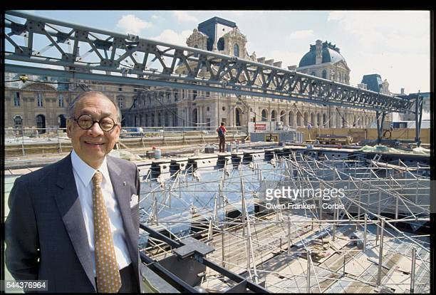 Architect IM Pei stands in front of the construction site for the Louvre's inverted pyramid He designed the glass and metal pyramids to serve as an...