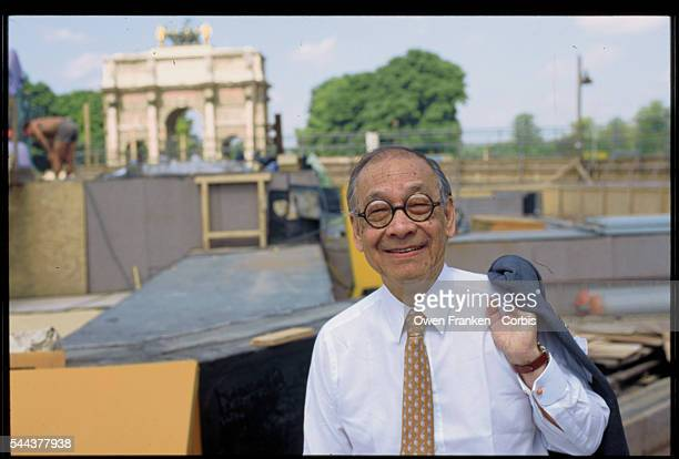 Architect IM Pei stands in front of the construction site for the Louvre pyramid He designed the glass and metal pyramid to serve as an entrance to...