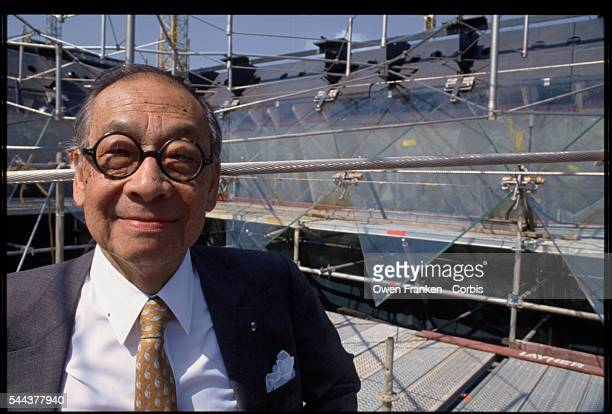 Architect IM Pei stands inside of the construction site for the Louvre's inverted pyramid He designed the glass and metal pyramids to serve as an...