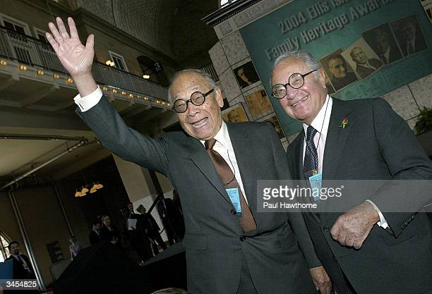 Architect IM Pei waves to family members as he speaks with Martin Segal before being honored with an Ellis Island Family Heritage Award at the Ellis...