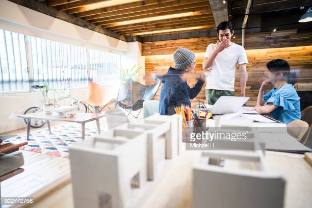 architect in discussion while working on project - model building stock photos and pictures