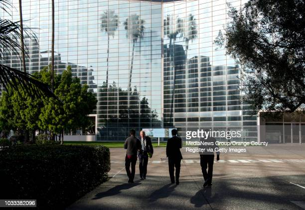 Architect Jim Wirick, second from left, leads a tour of the renovation work being done at the Tower of Hope at Christ Cathedral, formerly Crystal...