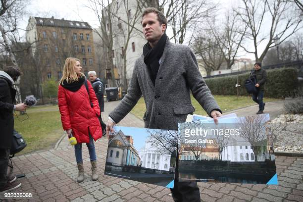 Architect Kilian Endersvon holds pictures of his proposal for rebuilding the former Fraenkelufer synagogue during a press event at the synagogue...