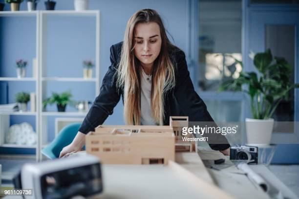 architect looking at architectural model in office - architectural model stock pictures, royalty-free photos & images