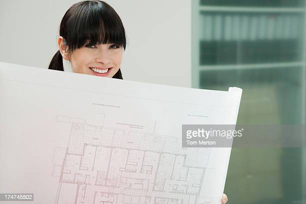 Architect looking at drafts in office