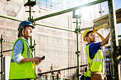 Architect looking at worker working at site