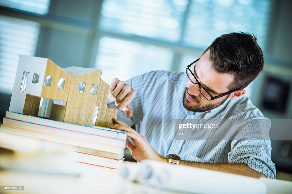 Architect making architectural model : Stock Photo