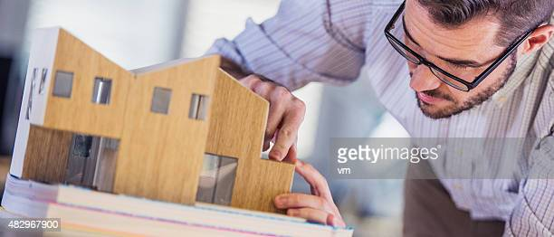 Architect making architectural model