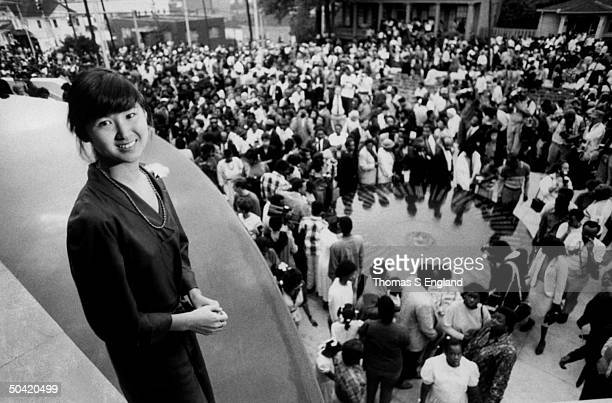 Architect Maya Lin standing on balcony of building where her civil rights monument is being dedicated at the Southern Poverty Law Center where civil...
