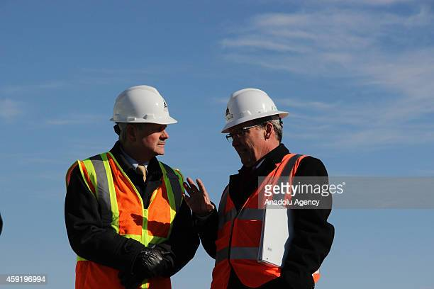 Architect of the Capitol Stephen Ayers and Senator John Hoeven talk during the US Capitol Dome Restoration Project news conference on November 2014
