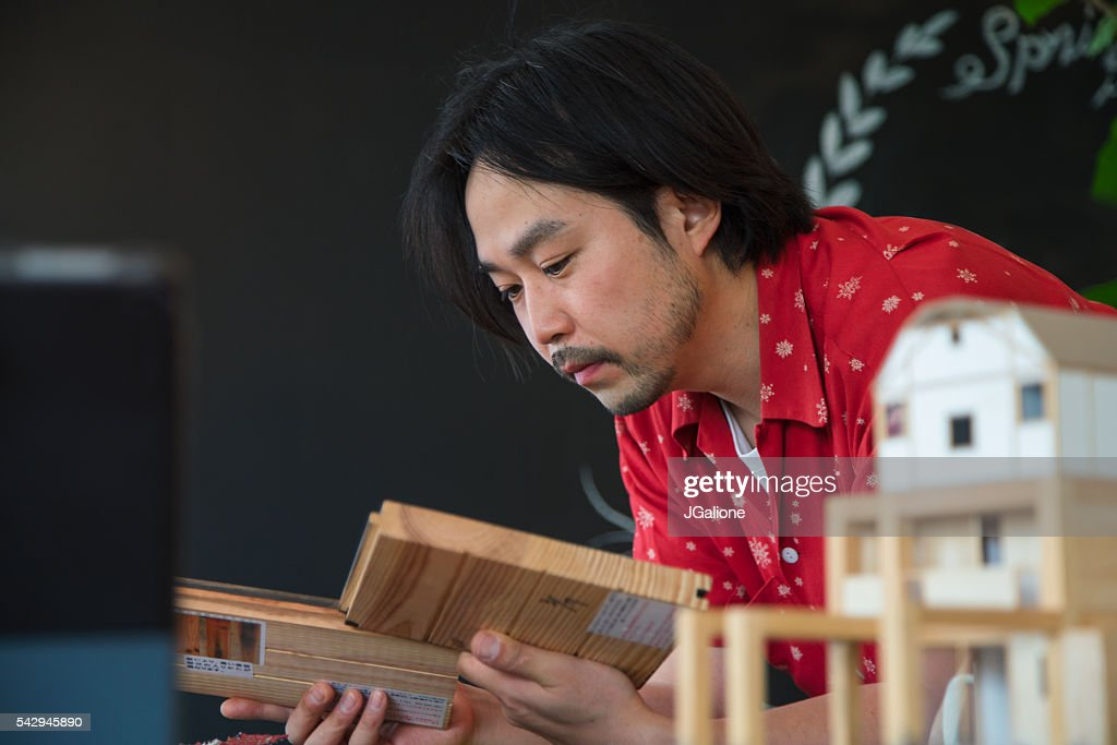 Architect Or Designer Looking At Wood Samples : Stock Photo