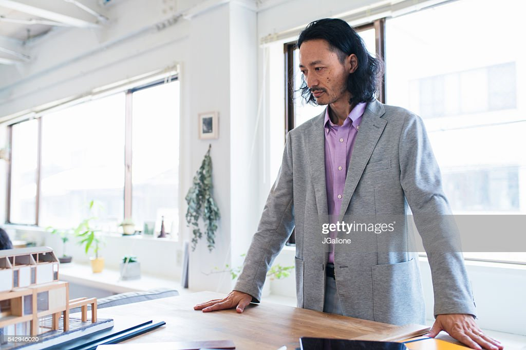 Awesome Architect Or Designer Thinking : Stock Photo