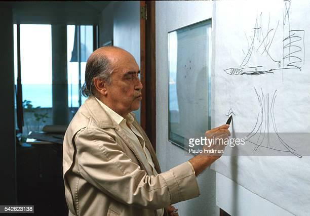 Architect Oscar Niemeyer sketches in his studio in Copacabana Rio de Janeiro Brazil
