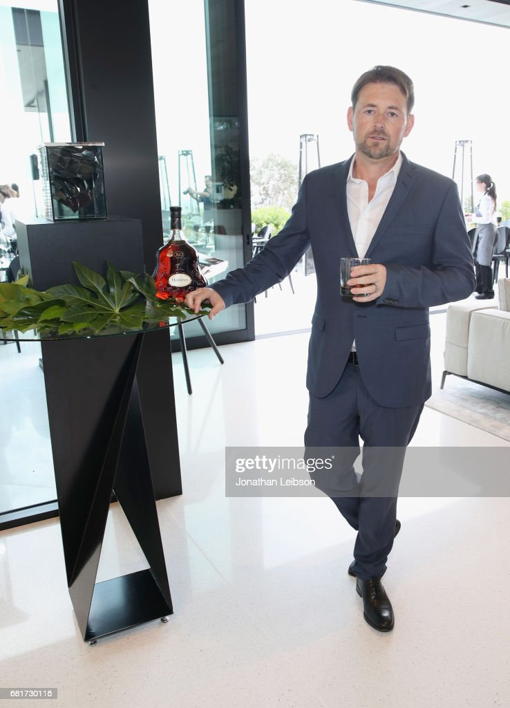 Architect Paul McClean poses by Paul's newly designed Hennessy X.O ice bucket during a private dinner in Beverly Hills, CA on May 10, 2017. The 3-D printed ice bucket encourages serving Hennessy X.O, the world's original Extra Old Cognac, on ice to best enjoy the spirit's multisensory taste odyssey.