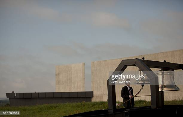 Architect Paul Murdoch rings the ceremonial bells at the Flight 93 National Memorial during the 14th anniversary of the 9/11 attack in Shanksville...