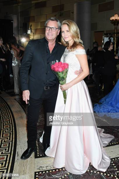 Architect Peter Cook and model Sailor BrinkleyCook pose backstage during the NYFW Sherri Hill Runway Show on February 9 2018 in New York City