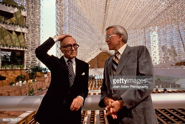Architect Phillip Johnson and Robert Schuller pose for a photo in the newly constructed Crystal Cathedral in 1980 in Garden Grove California