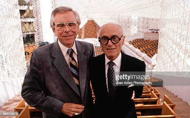 Architect Phillip Johnson and Robert Schuller pose for a photo in the newly constructed Crystal Cathedral in 1980 in Garden Grove, California.