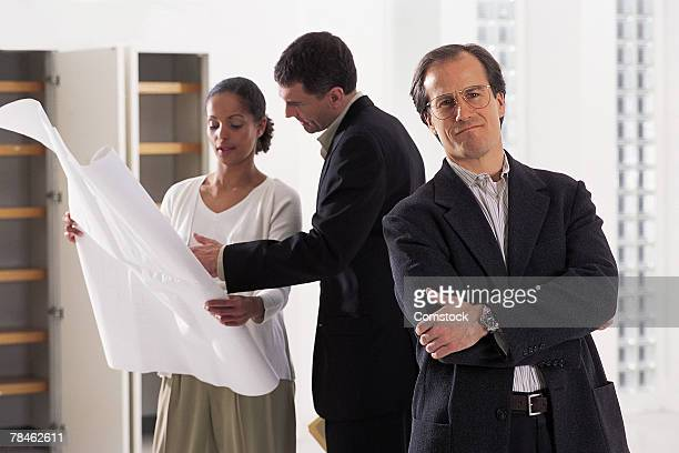 architect posing in office with others - category:cs1_maint:_others stock pictures, royalty-free photos & images