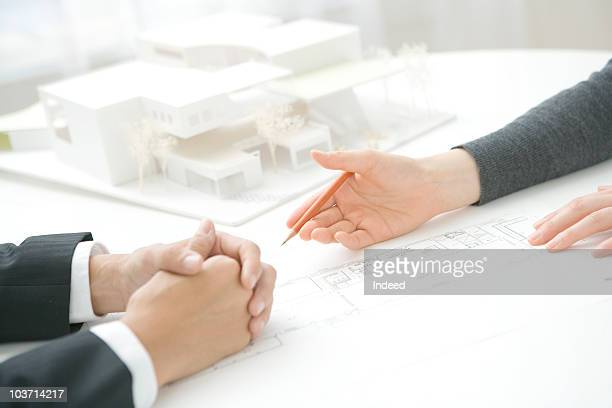 Architect presenting plans to businessman