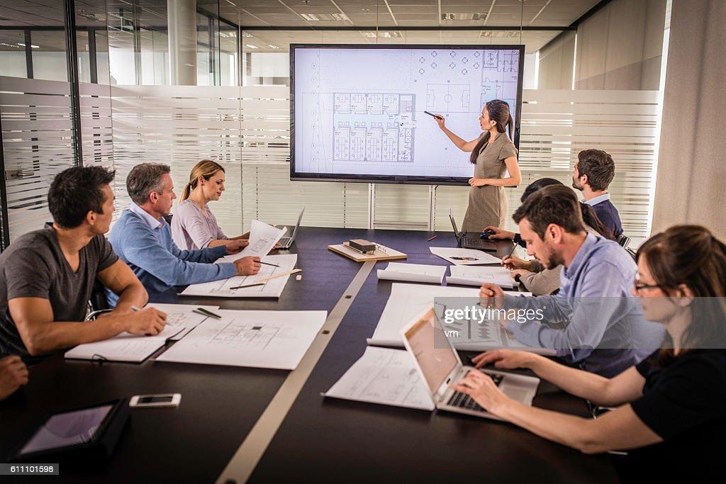 Architect presenting project plan : Stock Photo