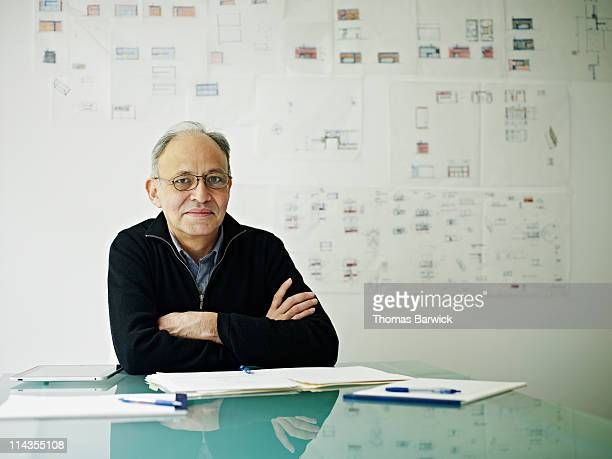 Architect sitting at conference table in office