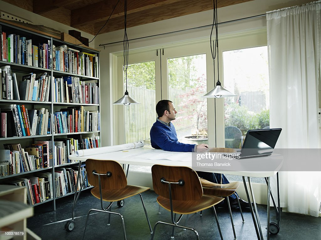 architect home office. Architect Sitting At Table In Home Office : Stock Photo