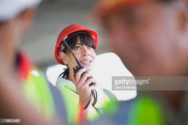 Architect speaking into walkie-talkie