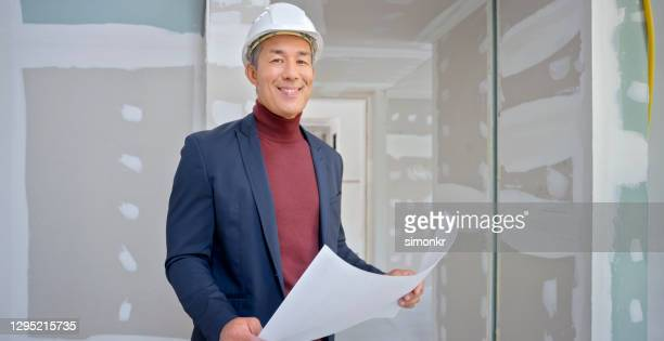architect standing at construction site - mock turtleneck stock pictures, royalty-free photos & images