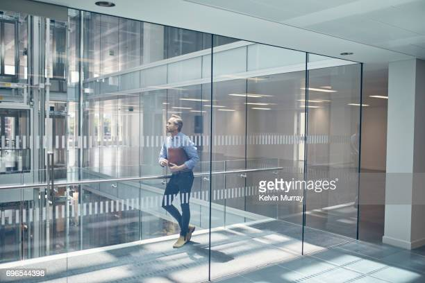 Architect standing in office hallway
