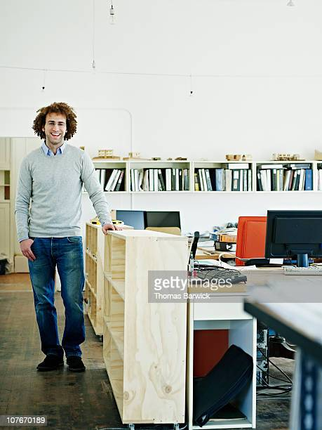 Architect standing in office smiling