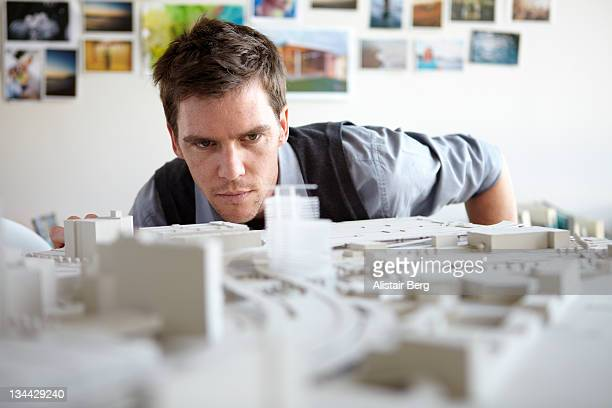 architect studying model - architectural model stock pictures, royalty-free photos & images