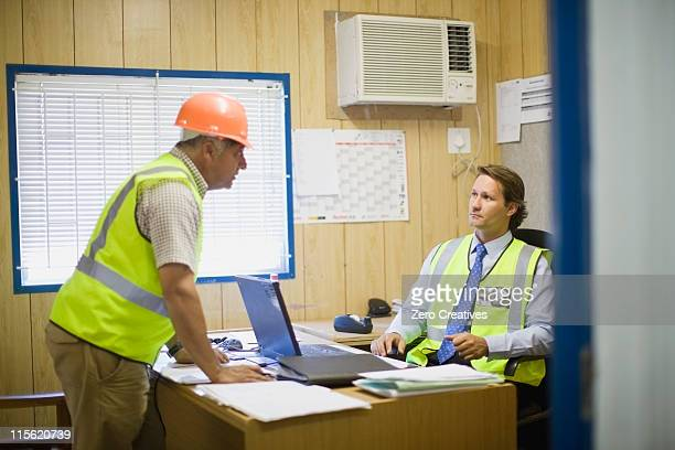 Architect talking to a building worker