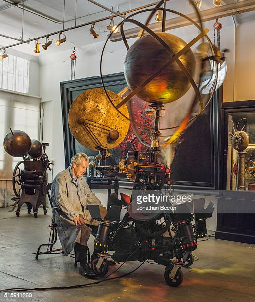 Architect Thierry Despont is photographed surrounded by his orb sculptures and paintings for Vanity Fair Magazine on July 28, 2014 in Tribeca art...