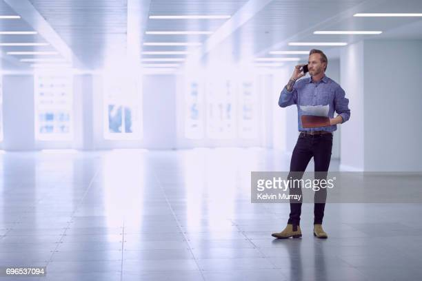 Architect using cell phone in empty office