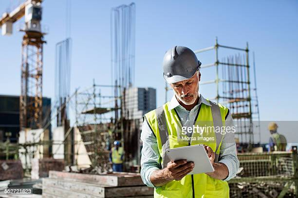 Architect using digital tablet at site