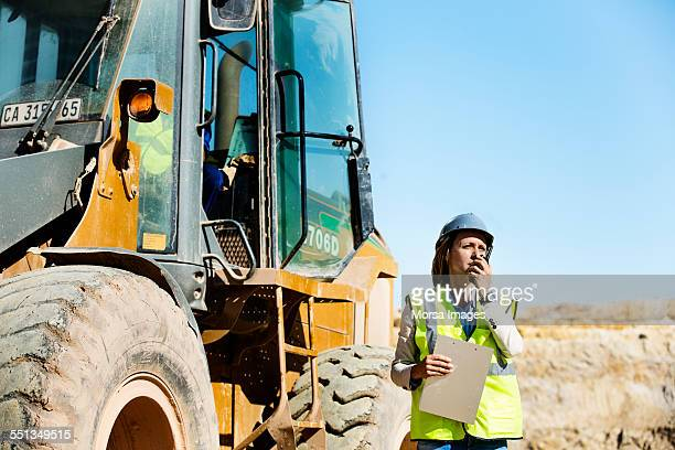 architect using walkie-talkie at quarry - human rights stock pictures, royalty-free photos & images