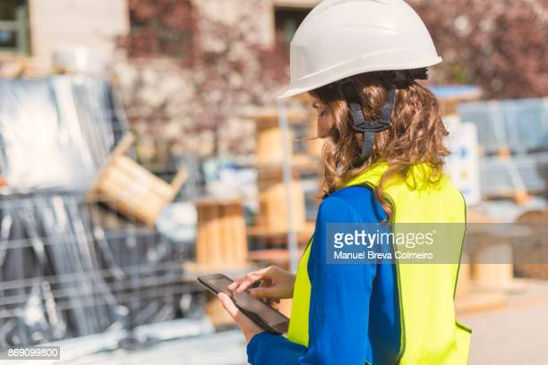 architect with a digital tablet - sex discrimination stock photos and pictures