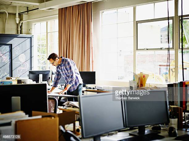 Architect working at workstation in office