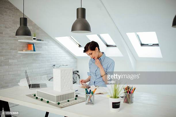 Architect Working In Her Office.