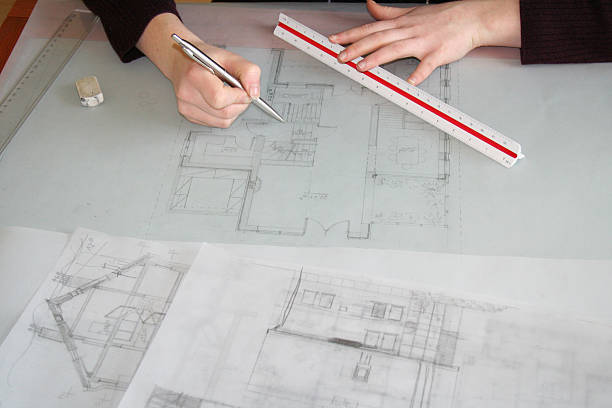 Free tracing images pictures and royalty free stock photos architect working on a blueprint malvernweather Images