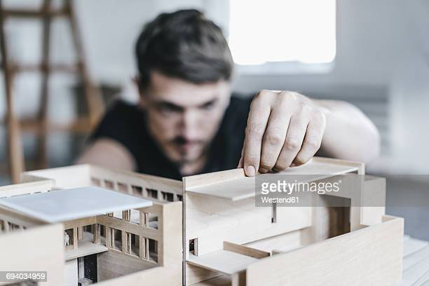 Architect working on architectural model