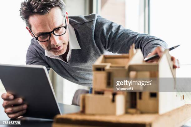 architect working on architectural model - architectural model stock pictures, royalty-free photos & images