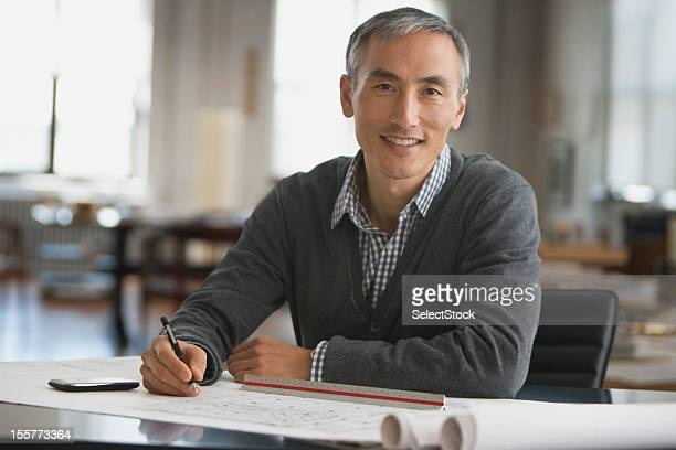 architect working on blue prints - chinese ethnicity stock pictures, royalty-free photos & images