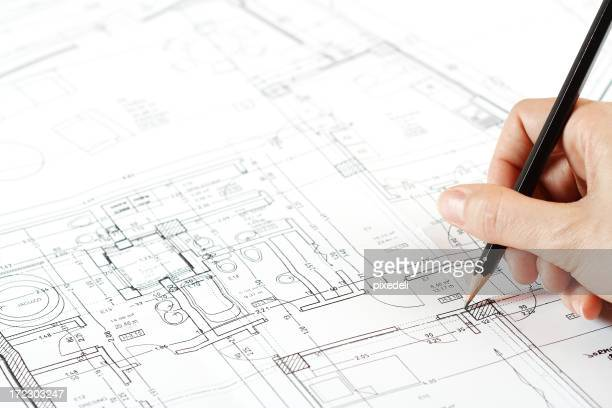 Architect working on blueprint projects