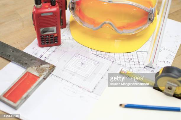 Architect working on blueprint.engineer inspective in workplace - architectural project, blueprints'
