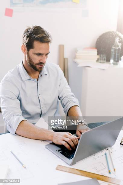 Architect working on laptop in his office