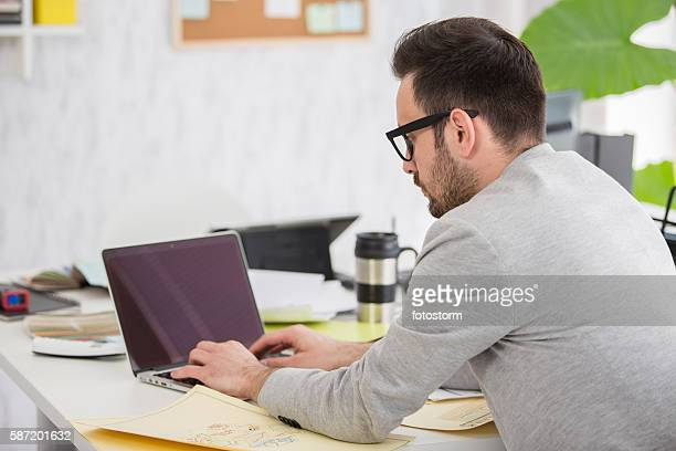 Architect working on laptop  in his studio